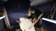 MS Shaper hand sanding surfboard / Wadebridge, Cornwall, United Kingdom
