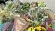 Mother calls for others to join fight for justice T10091538 / 1092015 ENGLAND London EXT Flowers left outside beauty salon owned by Sharon Fearon in...