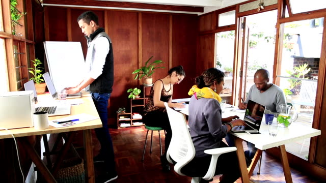 Shared creative work space with multi ethnic people