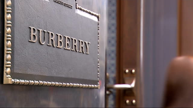 Shareholders decline Burberry Chief Executive's pay rise London EXT Exterior of Burberry store with people walking past 'Burberry' plaque on wall BV...