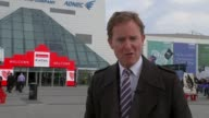 BP shareholders reject 14 million pound pay deal for Chief Executive ExCel London sign on building Reporter to camera