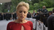 INTERVIEW Sharon Stone on being at AmfAR at AmfAR Red Carpet at Hotel du CapEdenRoc on May 22 2014 in Cap d'Antibes France