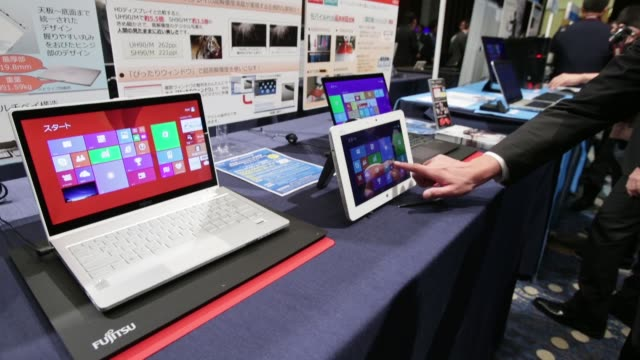 A Sharp Corp Mebius Pad tablet running Microsoft Corp's Windows 81 operating system sits on display during a launch event for the operating system in...