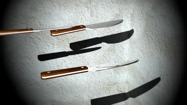 Sharp kitchen knives hit a target