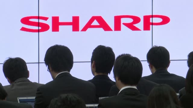Sharp skyrockets with the hard hit Japanese electronics giant saying it is mulling rival bailout offers including one from Foxconn parent company Hon...