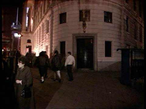 Trafalgar Square AV Floodlit facade of South African Embassy in London TILT DOWN as people walking past Embassy INT CMS JUSTUS DE GOEDE INTVW SOF 'I...