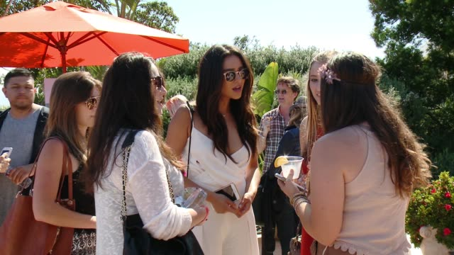 Shay Mitchell with friends at Children Mending Hearts 7th Annual Fundraiser 'Empathy Rocks' on June 14 2015 in Malibu California