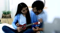 She plays guitar and sing for him.HD format.