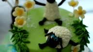 Sheep decorating a birthday cake