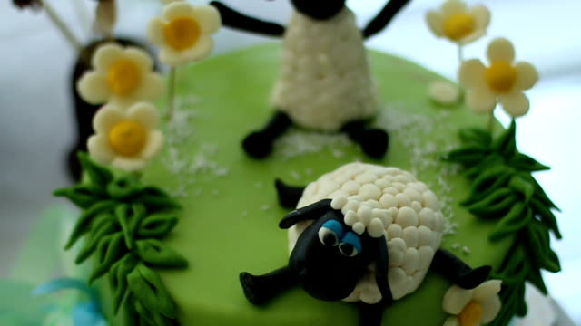 Sheep decorating a birthday cake