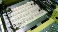CU, HA, Sheets of American five dollar bills moving fast on conveyor, Washington DC, USA