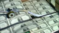 MS, Sheets of American one dollar bills moving fast on conveyor, Washington DC, USA