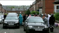 funeral ENGLAND Yorkshire Sheffield Sharrow EXT Funeral cortege and large crowd of mourners pause outside house Mourners gathered outside Madina...