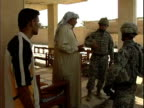 Sheik talking with US soldiers about Concerned Local Citizens volunteer program / Haswa Iraq / AUDIO