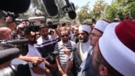 Sheikh Omar Qiswani head of the Islamic Waqf and worshippers perform prayers outside one of the main entrances to the AlAqsa mosque refusing to enter...