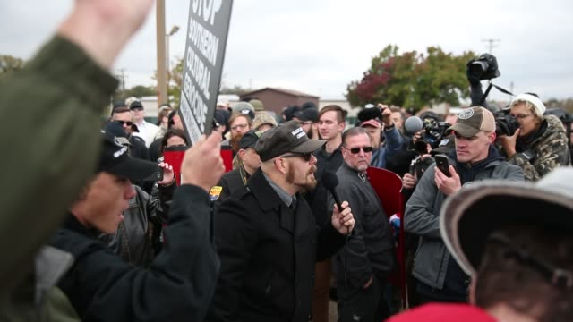 A man wearing a 'Make America Great Again' hat speaks against Somalian refugees Mexican immigrants and others as White Nationalist groups gather for...