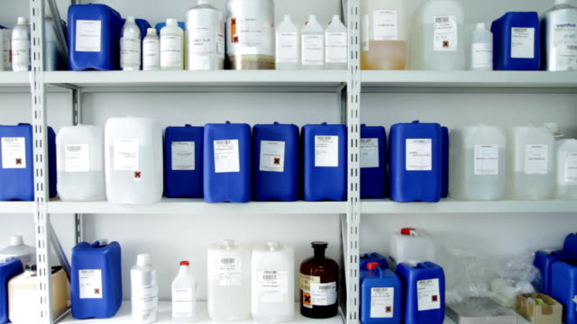 Shelf full of chemicals in plastic containers