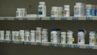 shelves of drugs at pharmacy