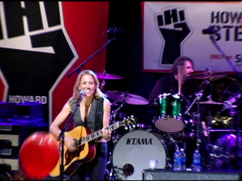 Sheryl Crow performs for fans at the Howard Stern Last Day Live Event arrivals and Inside at Hard Rock Cafe in New York New York on December 16 2005