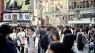 Shibuya Crossing Intersection Crowd Slow motion Tokyo Japan.
