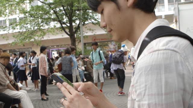 Shibuya Station Japanese Young Man Texting Tokyo Japan.