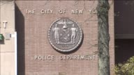 NYPD shield outside of the 105th precinct