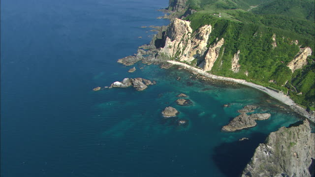 Shimamui coast touching the expanse of blue sea tinged with the socalled Shakotan BlueAerial Shot in panning around Wide and Long Shot The beautiful...