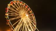 Shiny ferris wheel in the night.
