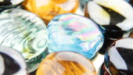 Shiny multicolored glass pebbles - loopable