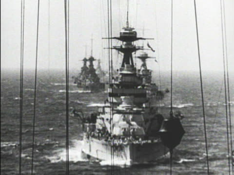 Battleships in line on ocean TD WS Single ship of convoy HA BEHIND People waving to returning or leaving ship moving into or out of port