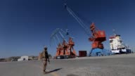 A ship carrying containers are seen during the opening of a trade project in Gwadar port west of Karachi on November 13 2016 Pakistani Prime Minister...