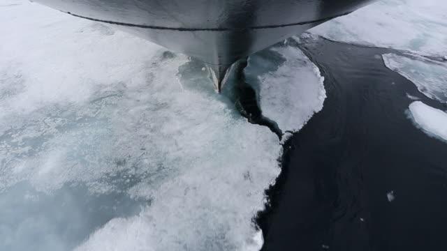 Ship carving through ice