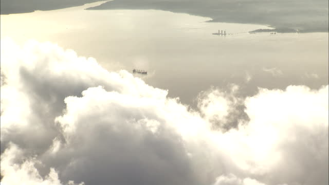 A ship drifts on the Amazon River beneath clouds. Available in HD.