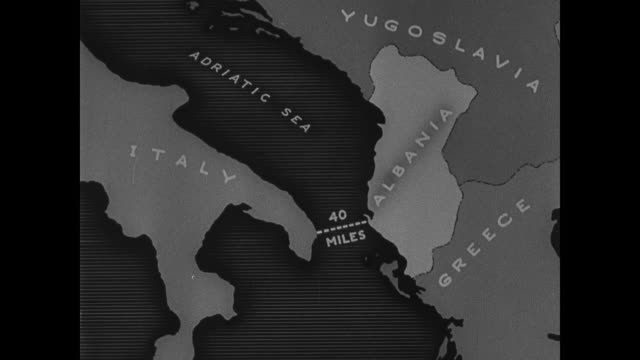 Ship in harbor Italian ship in harbor Fort on island of Sazan at entrance to Bay of Vlora ANIMATED MAP showing distance from Italy to Albania