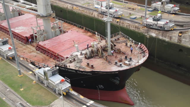 A ship rises in the Canal of Panama