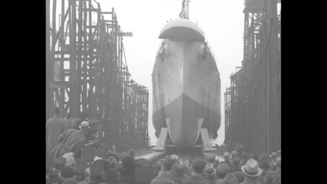 Ship sponsor Salome Clark at right holding roses stands with her father Idaho Govelect Barzilla Clark and others as she waits to christen the USS...