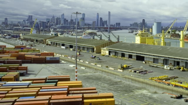 WS T/L ZI Shipping containers at Swanston Dock, skyline in background / Melbourne, Victoria, Australia
