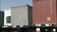 Shipping containers line a container terminal in Los Angeles.