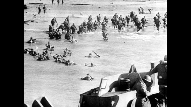 / Ships firing on each other explosions and American soldier narrative / more troops arrive at Omaha Beach during DDay invasion / soldiers march off...