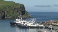 Ships moor in Shakotan Bay off the coast of Shikotan Island.