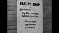 Shipyard Beauty Shop INT women having hair amp nails done Woman getting manicure Woman under hairdryer Hairdresser brushing woman's hair EXT WS Saks...