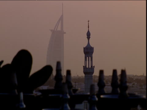 Shisha pipes are stacked outside rooftop cafe Burj al Arab in distance Dubai