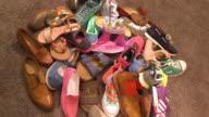 shoe shop, heap of shoes, pan shot around the shoes