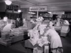 Shop assistants sort out sale items in the bed linen section of a department store