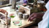 Shopkeeper preparing paan, Delhi, India