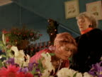 MS Shopkeeper suggesting flowers to customer who disagrees, New Zealand
