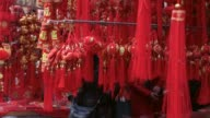 A shopper browses through decorations at an ornament market in the Yuyuan district ahead of the Lunar New Year in Shanghai China on Sunday Jan 22...