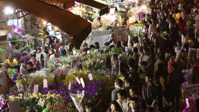 Shoppers browse flowers displayed for sale for the Lunar New Year on Flower Market Road in the Mongkok district of Hong Kong China Mongkok Flower...