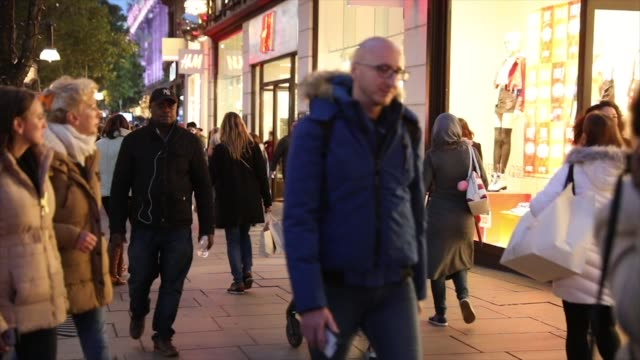 Shoppers carry bags as they walk down Oxford Street in central London UK on Tuesday Nov 7 2017