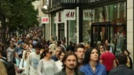 Shoppers cross the street outside a Next retail store operated by Next Plc on Oxford Street in London UK on Wednesday Aug 19 2015 Shots wide shto of...